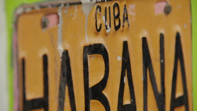 slow motion tilt down over close-up of license plate saying cuba habana - havana stock videos & royalty-free footage