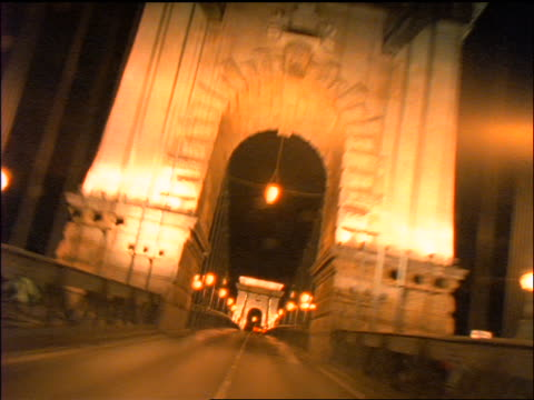 slow motion time lapse car point of view on chain bridge at night / budapest, hungary - chain bridge suspension bridge stock-videos und b-roll-filmmaterial