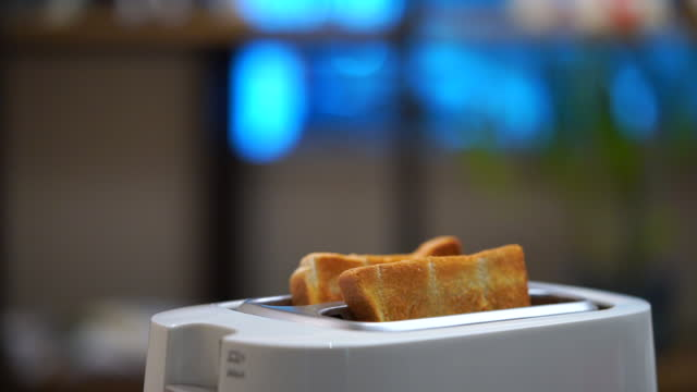 slow motion toast popping up from toaster - toaster appliance stock videos & royalty-free footage
