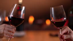 Slow motion toast with red wine