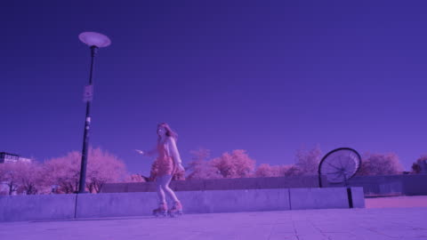 slow motion toned image of girl dancing and roller skating in plaza / salt lake city, utah, united states - toned image stock videos & royalty-free footage