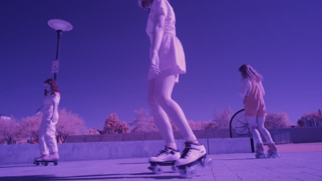 slow motion toned image of girls dancing and roller skating in plaza / salt lake city, utah, united states - toned image stock videos & royalty-free footage