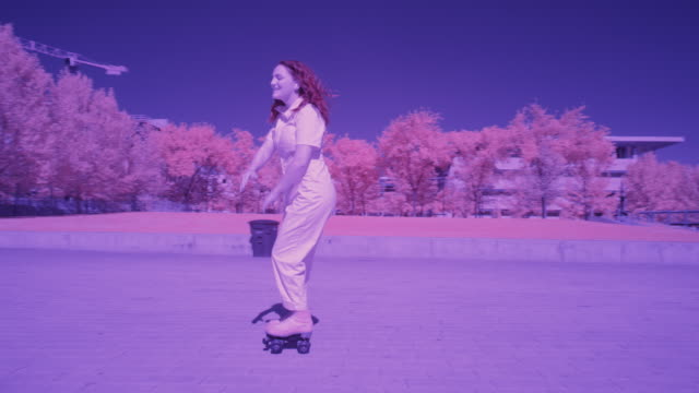 slow motion toned image tracking shot of girl dancing on roller skates / salt lake city, utah, united states - toned image stock videos & royalty-free footage
