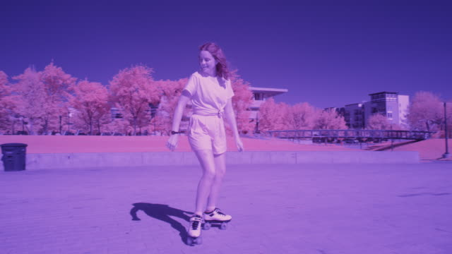 slow motion toned image tracking shot of smiling girl roller skating / salt lake city, utah, united states - toned image stock videos & royalty-free footage