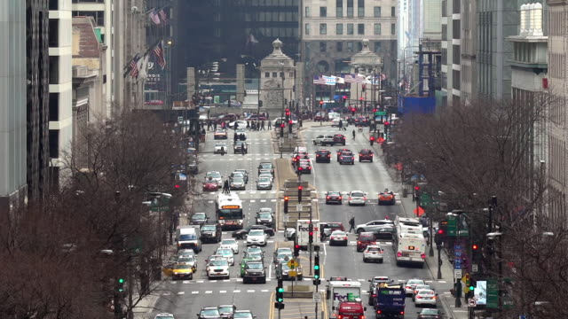 slow motion top view pedestrian crowded and car traffic transportation on magnificent mile michigan avenue shopping street district of chicago michigan avenue, united states.  american lifestyle concept and commuter transport. - michigan avenue bridge stock videos & royalty-free footage