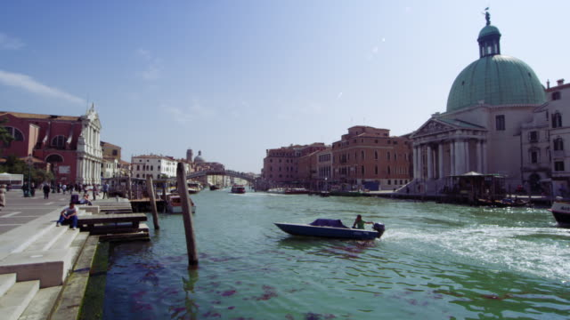 Slow motion tracking shot of boat travel on the Grand Canal