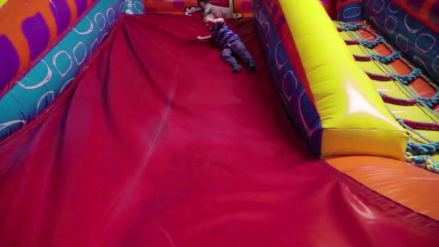 slow motion: trampoline fun - rolled up stock videos & royalty-free footage