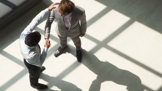 slow motion: two male business partner shaking each other hands - businessman video stock e b–roll