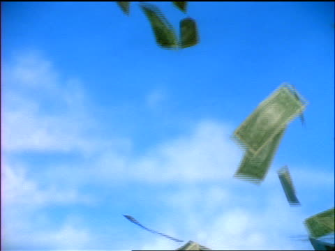 slow motion us dollars floating out of sky / blue skies in background - american one dollar bill stock videos & royalty-free footage