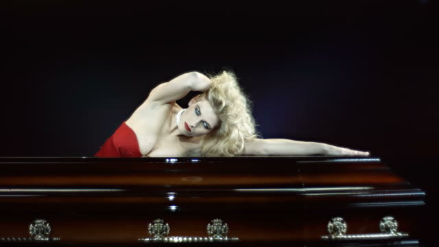 hd slow motion: vampire leaning on a luxury coffin - coffin stock videos and b-roll footage