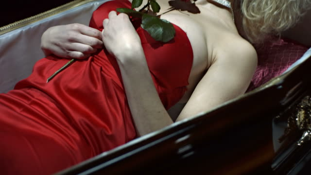 hd slow motion: vampire lying down in a coffin - coffin stock videos & royalty-free footage