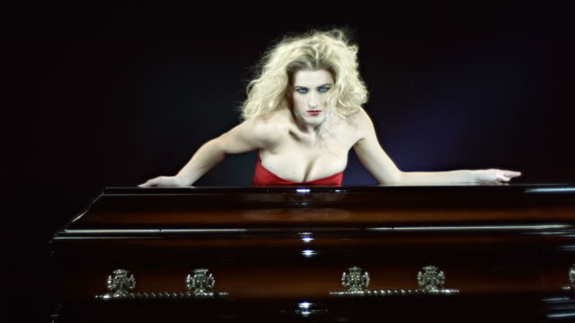 hd slow motion: vampire sensual moving behind a coffin - coffin stock videos and b-roll footage