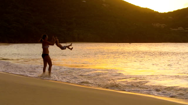slow motion video of a boy jumping at the beach - st. john virgin islands stock videos & royalty-free footage
