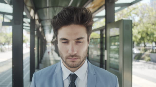 slow motion video of a businessman opening his eyes and looking at camera - eyes closed stock videos & royalty-free footage