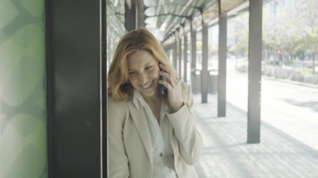 slow motion video of a businesswoman in the city calling with smartphone - avenida 9 de julio stock videos & royalty-free footage
