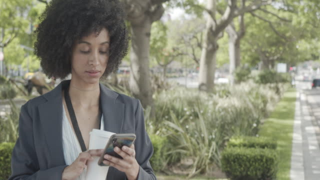 slow motion video of a businesswoman with afro hair in the city - avenida 9 de julio stock videos & royalty-free footage