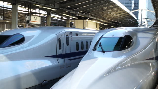 slow motion video of a classic bullet train at tokyo central station - japan 20109. - high speed train stock videos & royalty-free footage