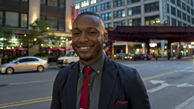 Slow motion video of a proud businessman in downtown Chicago