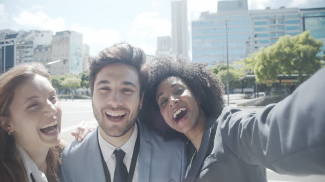 slow motion video of a team of three business people taking a selfie together in the city - avenida 9 de julio stock videos & royalty-free footage