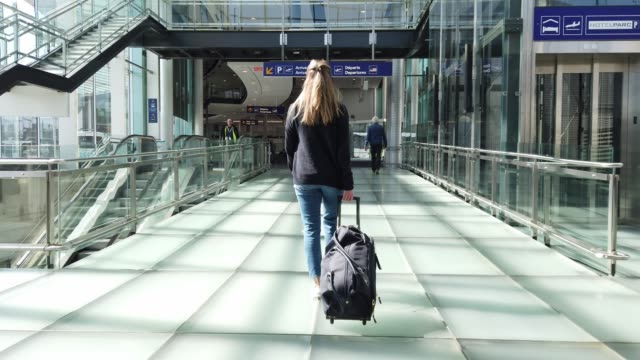 slow motion video of a woman walking in an airport. - montréal stock videos & royalty-free footage