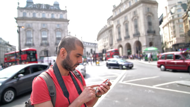 Slow Motion Video Of Adult Man Using Smartphone On Street, London, UK