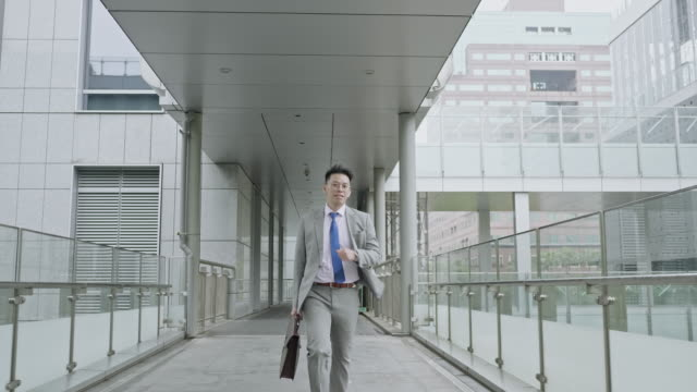 slow motion video of asian young businessman running to work - full length stock videos & royalty-free footage