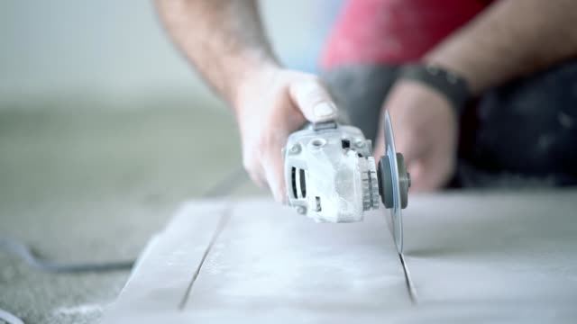 slow motion video of cutting ceramic tile - tile stock videos & royalty-free footage