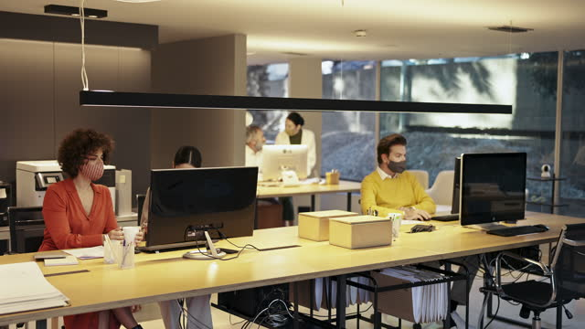 Slow Motion Video of Design Team at Workstation in Modern Office During Pandemic