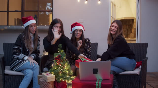 slow motion video of friends celebrating christmas together with other people during a video call - virtual event stock videos & royalty-free footage