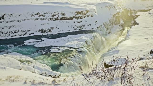 Slow motion video of Gulfoss waterfall at sunset