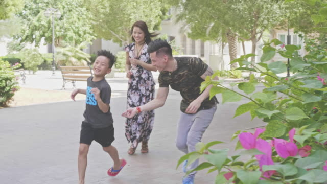 slow motion video of happy filipino family having fun outdoors - filipino ethnicity stock videos & royalty-free footage