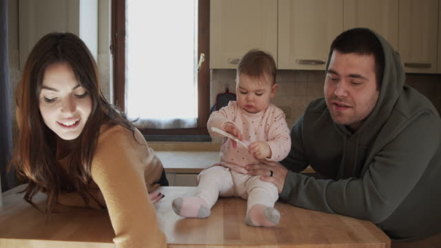 slow motion video of happy mother and father with their little daughter - young family stock videos & royalty-free footage
