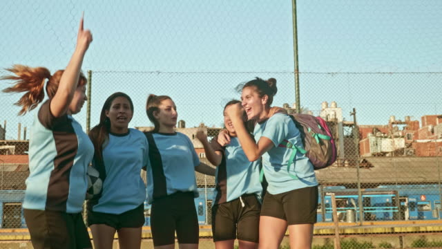 slow motion video of happy young female footballers celebrating success - team sport stock videos & royalty-free footage