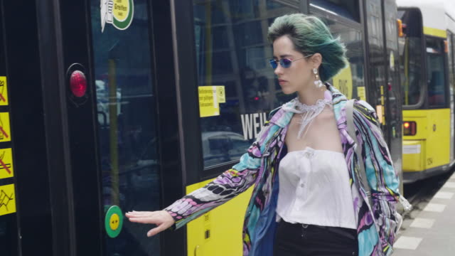 slow motion video of hipster girl with green hair commuting in berlin by tram - tram stock videos & royalty-free footage