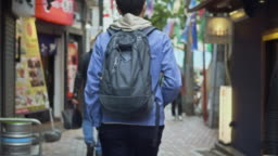 Slow motion video of Japanese man searching a place in the city
