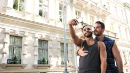 Slow motion video of LGBT couple traveling in summer and taking selfie