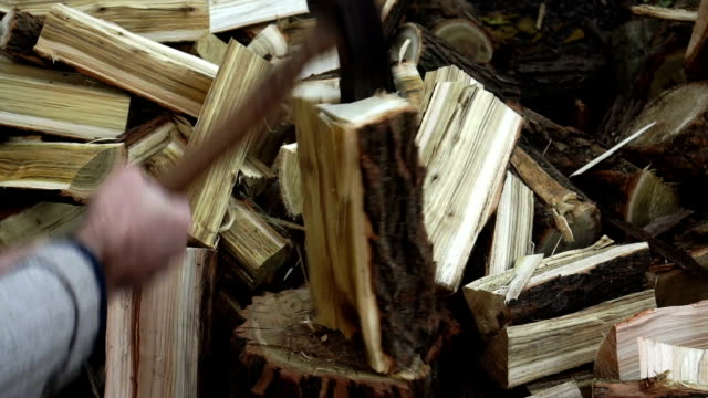 slow motion video of man chopping wood - firewood stock videos & royalty-free footage