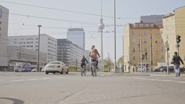 slow motion video of people cycling in berlin to work, germany - cable car stock videos & royalty-free footage