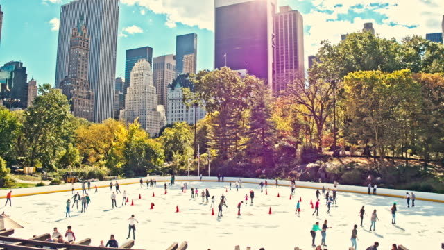 slow motion video of people ice-skating in central park, new york, usa - ice rink stock videos & royalty-free footage