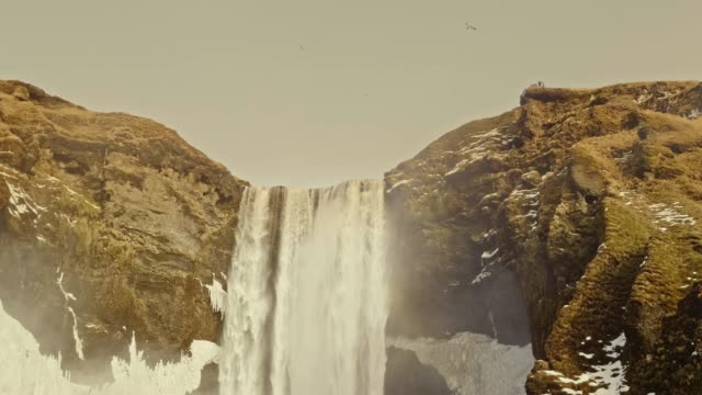 slow motion video of skogafoss waterfall at winter - low angle view stock videos & royalty-free footage