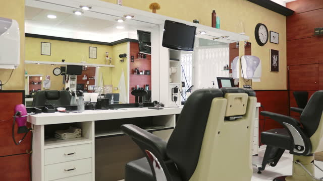 slow motion video of styling stations in modern hair salon - hairdresser stock videos & royalty-free footage