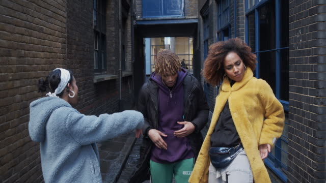 slow motion video of three hip friends dancing together outdoor in the city - multiracial group stock videos & royalty-free footage