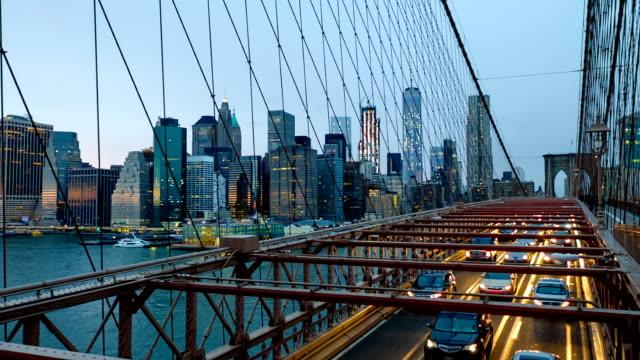 Slow Motion video of traffic in Brooklyn Bridge at dusk