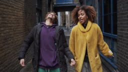 Slow motion video of two hip friends dancing together outdoor in the city