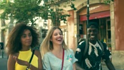 Slow motion video of young millennials friends having fun in the city