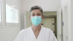 Slow Motion Video Portrait of Female Doctor Walking at Hospital Corridor