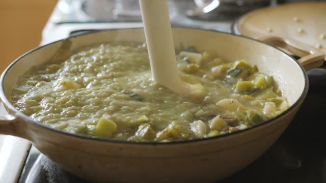 slow motion view of blending leek potato soup - potato soup stock videos & royalty-free footage