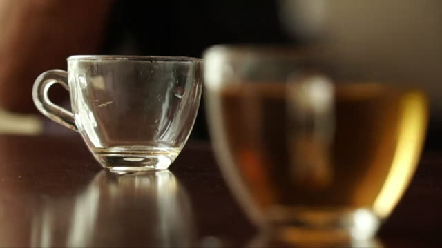slow motion view of chinese tea being poured - tea hot drink stock videos & royalty-free footage