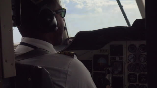 slow motion: view of pilot in cockpit with sunglasses on - pilot stock videos and b-roll footage
