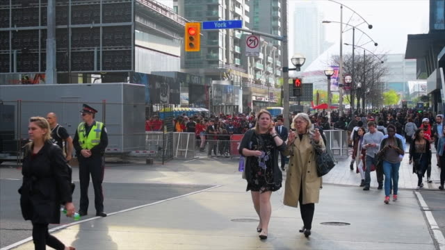 Slow motion view of the crowd outside the Scotiabank Arena for the first game of the NBA finals between the Toronto Raptors and the Golden State...